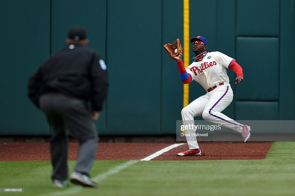 Domonic Brown #9 of the Philadelphia Phillies catches the ball in left field in the ninth inning against the Los Angeles Angels at Citizens Bank Park on May 14, 2014 in Philadelphia, Pennsylvania. The Angels won 3-0.