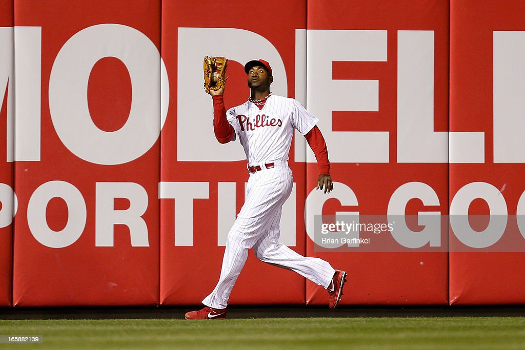 Domonic Brown #9 of the Philadelphia Phillies catches the ball in the outfield for an out in the 8th inning of the game against the Kansas City Royals at Citizens Bank Park on April 6, 2013 in Philadelphia, Pennsylvania. The Phillies won 4-3.