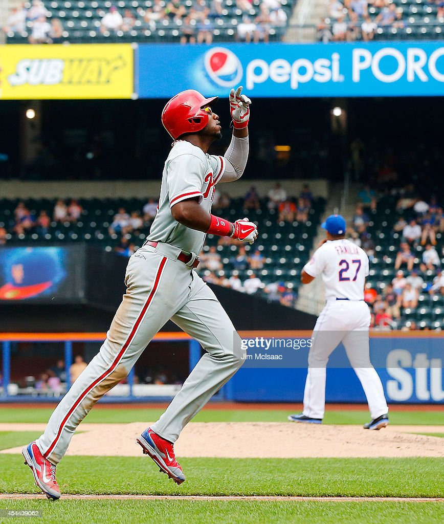<a gi-track='captionPersonalityLinkClicked' href=/galleries/search?phrase=Domonic+Brown&family=editorial&specificpeople=6900643 ng-click='$event.stopPropagation()'>Domonic Brown</a> #9 of the Philadelphia Phillies celebrates his eighth inning home run against <a gi-track='captionPersonalityLinkClicked' href=/galleries/search?phrase=Jeurys+Familia&family=editorial&specificpeople=8992911 ng-click='$event.stopPropagation()'>Jeurys Familia</a> #27 of the New York Mets at Citi Field on August 31, 2014 in the Flushing neighborhood of the Queens borough of New York City.