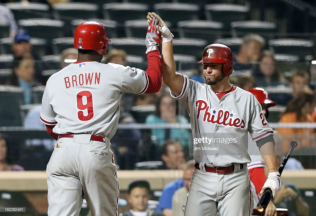 Domonic Brown #9 of the Philadelphia Phillies celebrates his seventh inning home run against the New York Mets with teammate <a gi-track='captionPersonalityLinkClicked' href=/galleries/search?phrase=Kevin+Frandsen&family=editorial&specificpeople=3982842 ng-click='$event.stopPropagation()'>Kevin Frandsen</a> #28 at Citi Field on September 17, 2012 in the Flushing neighborhood of the Queens borough of New York City.