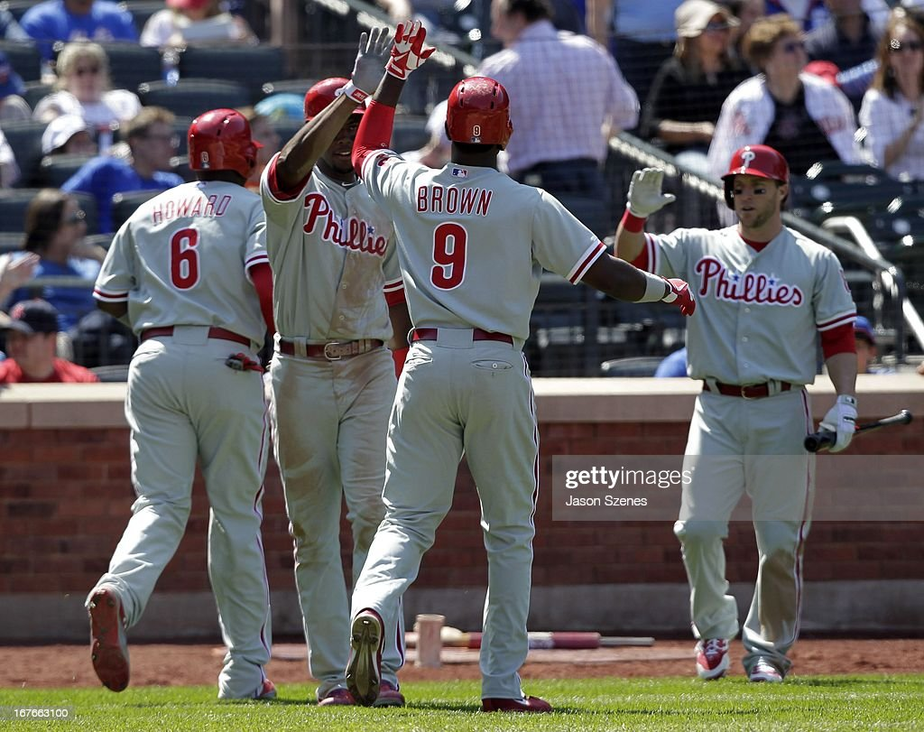 Domonic Brown #9 of the Philadelphia Phillies (C) celebrates his three run home run with his teammates in the fifth inning against the New York Mets at Citi Field on April 27, 2013 in the Flushing neighborhood of the Queens borough of New York City. (Photo by Jason Szenes/Getty Images