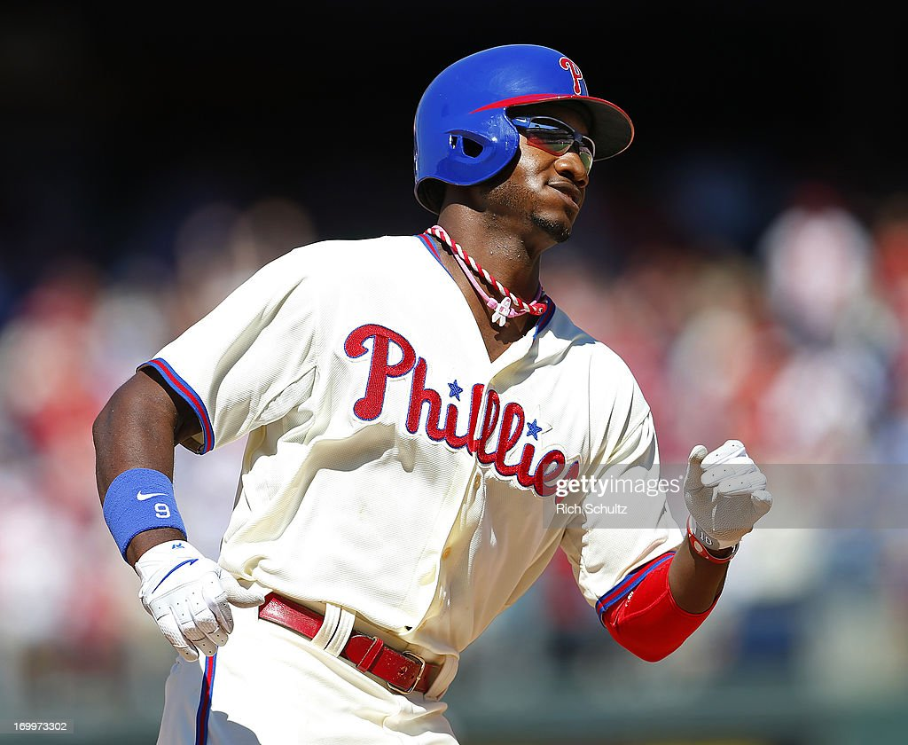 Domonic Brown #9 of the Philadelphia Phillies circles the bases after hitting a two run home run in the seventh inning against the Miami Marlins on June 5, 2013 at Citizens Bank Park in Philadelphia, Pennsylvania. The Phillies defeated the Marlins 6-1.