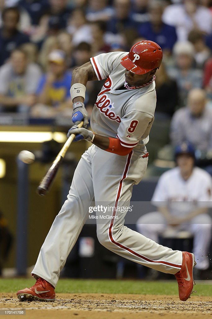 Domonic Brown #9 of the Philadelphia Phillies doubles in the top of the fourth inning against the Milwaukee Brewers at Miller Park on June 07, 2013 in Milwaukee, Wisconsin.