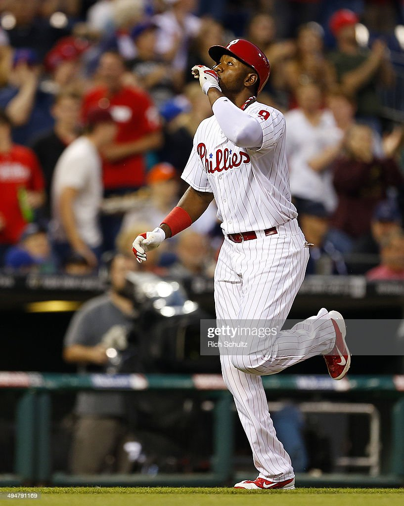 <a gi-track='captionPersonalityLinkClicked' href=/galleries/search?phrase=Domonic+Brown&family=editorial&specificpeople=6900643 ng-click='$event.stopPropagation()'>Domonic Brown</a> #9 of the Philadelphia Phillies gestures after he hit a three run home run against the New York Mets during the fourth inning in a game at Citizens Bank Park on May 30, 2014 in Philadelphia, Pennsylvania. The Phillies defeated the Mets 6-5 in 14 innings.