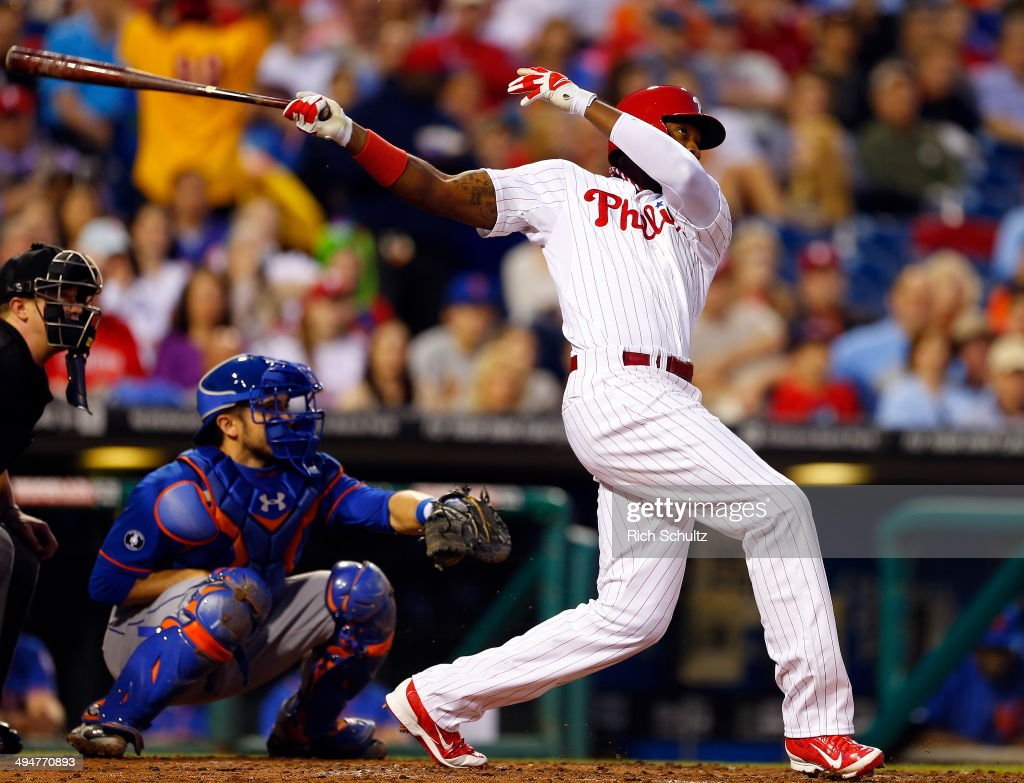 <a gi-track='captionPersonalityLinkClicked' href=/galleries/search?phrase=Domonic+Brown&family=editorial&specificpeople=6900643 ng-click='$event.stopPropagation()'>Domonic Brown</a> #9 of the Philadelphia Phillies hits a three run home run against the New York Mets during the fourth inning in a game at Citizens Bank Park on May 30, 2014 in Philadelphia, Pennsylvania.