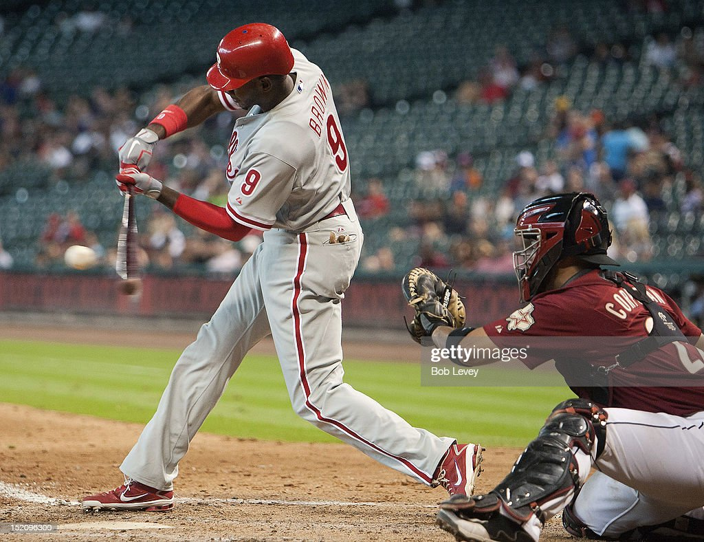 Domonic Brown #9 of the Philadelphia Phillies hits a two-run double in the eighth inning against the Houston Astros at Minute Maid Park on September 16, 2012 in Houston, Texas. Houston wins 7-6.