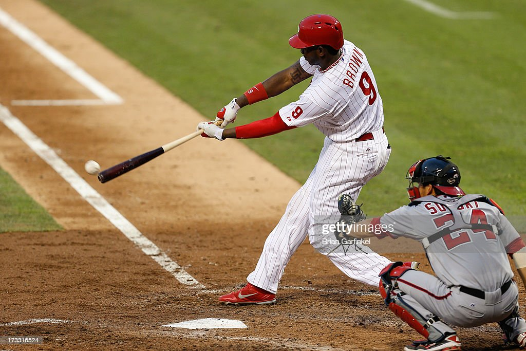 Domonic Brown #9 of the Philadelphia Phillies hits the ball for a base hit in the fourth inning of the game against the Washington Nationals at Citizens Bank Park on July 11, 2013 in Philadelphia, Pennsylvania.