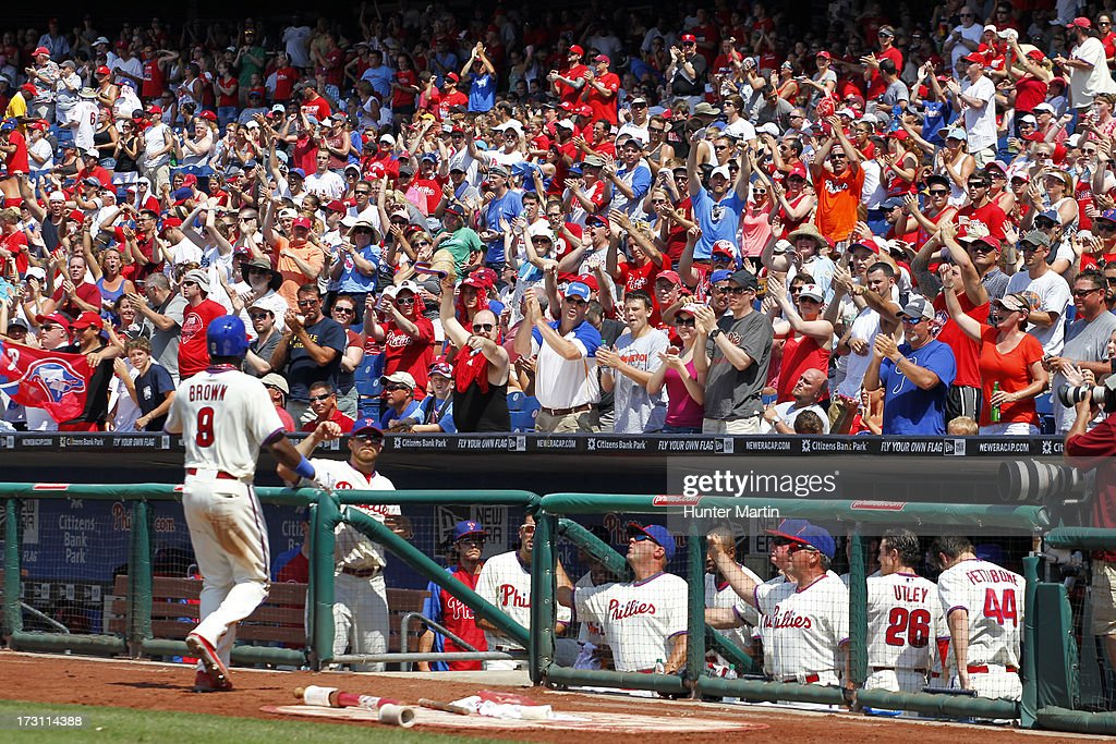 Domonic Brown #9 of the Philadelphia Phillies is cheered by fans as he returns to the dugout after hitting his 23rd home run of the season during a game against the Atlanta Braves at Citizens Bank Park on July 7, 2013 in Philadelphia, Pennsylvania. The Phillies won 7-3.