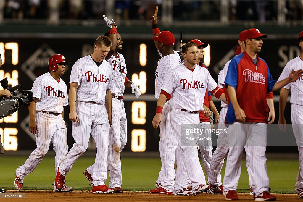 Domonic Brown #9 of the Philadelphia Phillies is congratulated by teammates after hitting an RBI single in the bottom of the ninth inning to win the game against the Washington Nationals at Citizens Bank Park on June 17, 2013 in Philadelphia, Pennsylvania. The Phillies won 5-4.