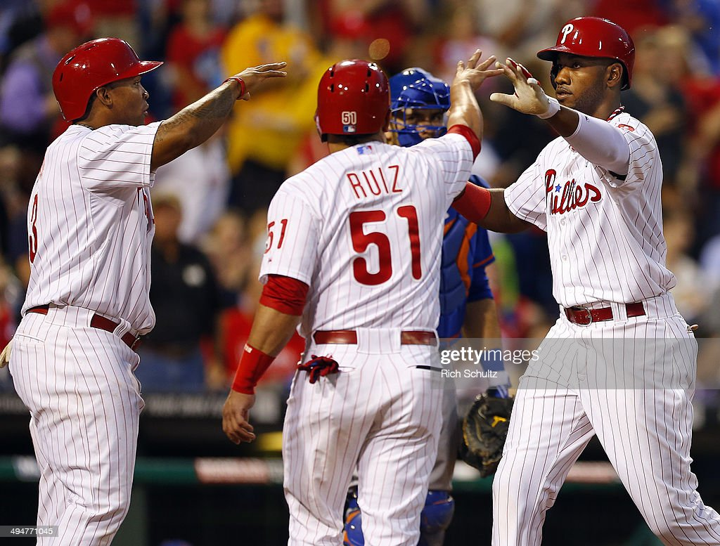 Domonic Brown #9 of the Philadelphia Phillies is congratulated by teammates Marlon Byrd #3 and Carlos Ruiz #51 after he hit a three run home run against the New York Mets during the fourth inning in a game at Citizens Bank Park on May 30, 2014 in Philadelphia, Pennsylvania.
