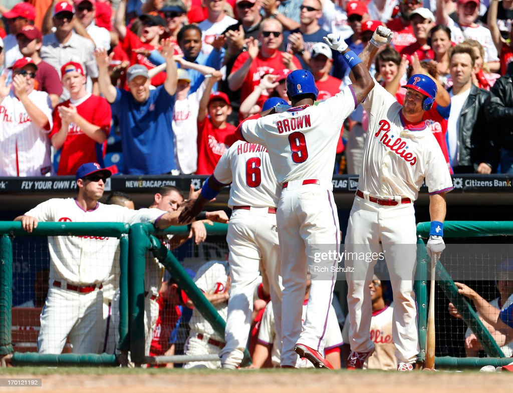 Domonic Brown #9 of the Philadelphia Phillies is congratulated by teammate Erik Kratz #31 after hitting a two run home run in the seventh inning against the Miami Marlins on June 5, 2013 at Citizens Bank Park in Philadelphia, Pennsylvania. The Phillies defeated the Marlins 6-1.