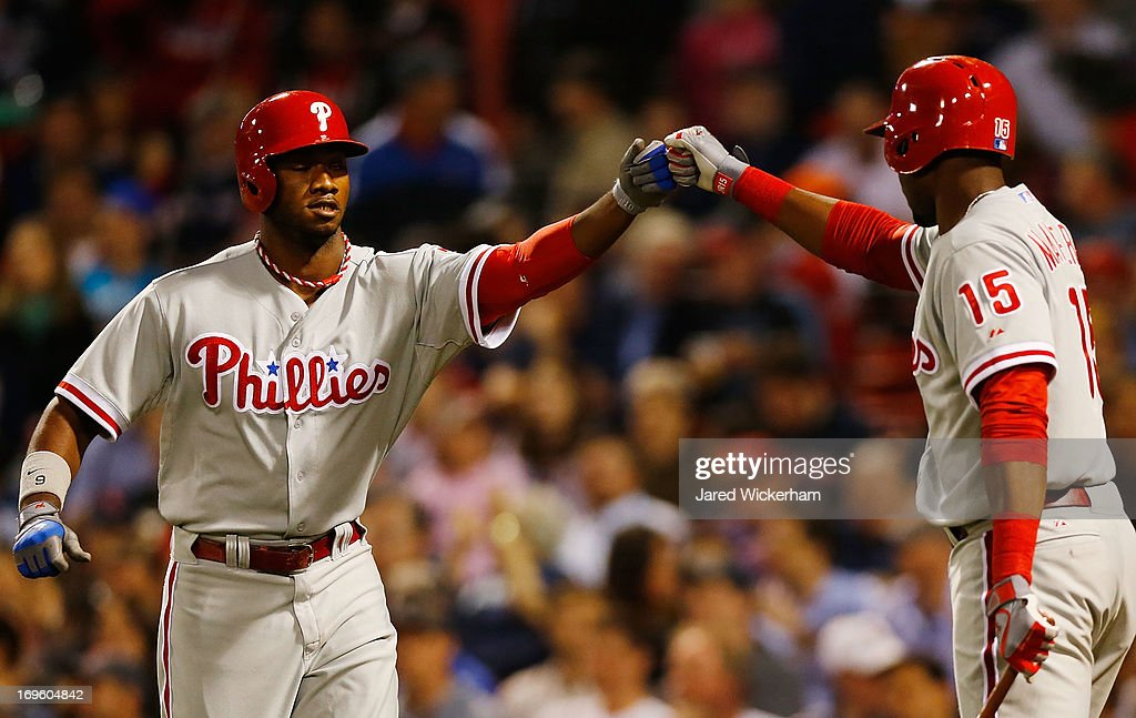 Domonic Brown #9 of the Philadelphia Phillies is congratulated by teammate <a gi-track='captionPersonalityLinkClicked' href=/galleries/search?phrase=John+Mayberry+Jr.&family=editorial&specificpeople=4959058 ng-click='$event.stopPropagation()'>John Mayberry Jr.</a> #15 of the Philadelphia Phillies after hitting a solo home run in the ninth inning against the Boston Red Sox during the interleague game on May 28, 2013 at Fenway Park in Boston, Massachusetts.