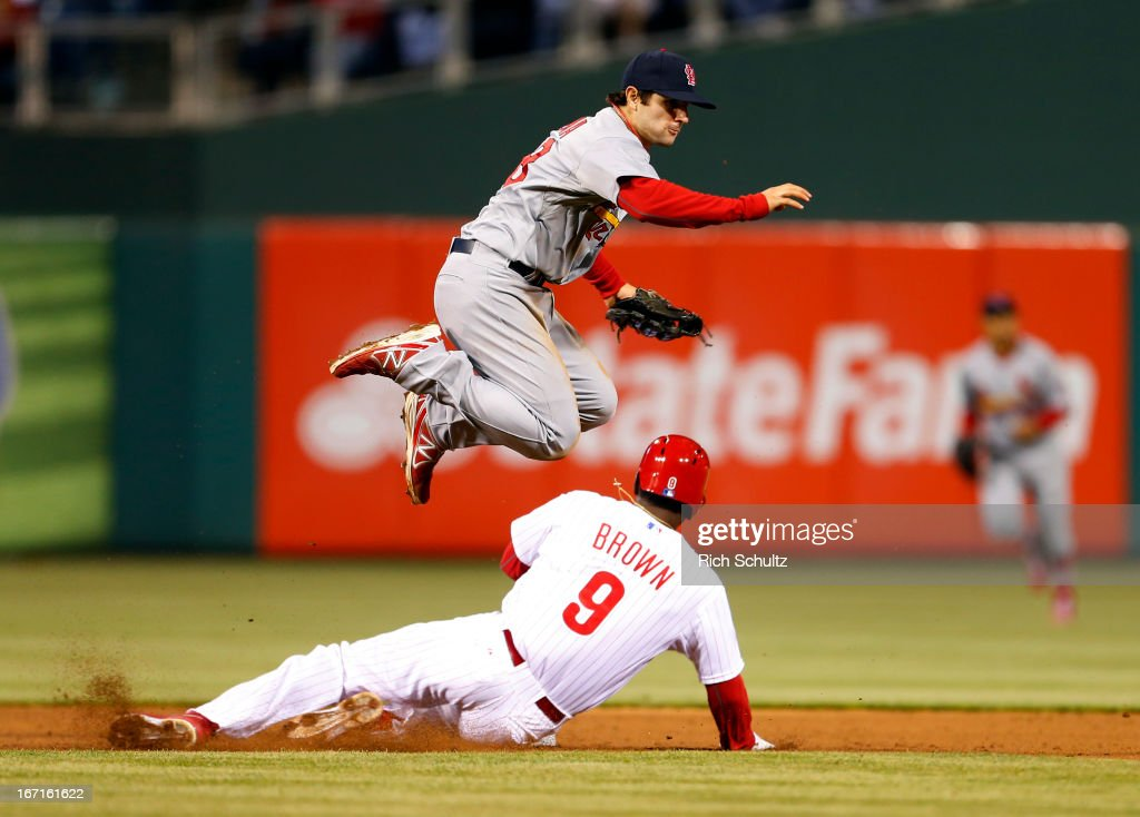 Domonic Brown #9 of the Philadelphia Phillies is out at second base as shortstop <a gi-track='captionPersonalityLinkClicked' href=/galleries/search?phrase=Pete+Kozma&family=editorial&specificpeople=6800748 ng-click='$event.stopPropagation()'>Pete Kozma</a> #38 of the St. Louis Cardinals throws to first to get the Phillies <a gi-track='captionPersonalityLinkClicked' href=/galleries/search?phrase=Ben+Revere&family=editorial&specificpeople=6826641 ng-click='$event.stopPropagation()'>Ben Revere</a> #2 to complete a double play to end the sixth inning in a MLB baseball game on April 21, 2013 at Citizens Bank Park in Philadelphia, Pennsylvania.