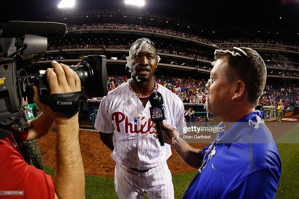 Domonic Brown #9 of the Philadelphia Phillies is seen after receiving a shaving cream pie while being interviewed after the game against the Washington Nationals at Citizens Bank Park on June 17, 2013 in Philadelphia, Pennsylvania. The Phillies won 5-4.