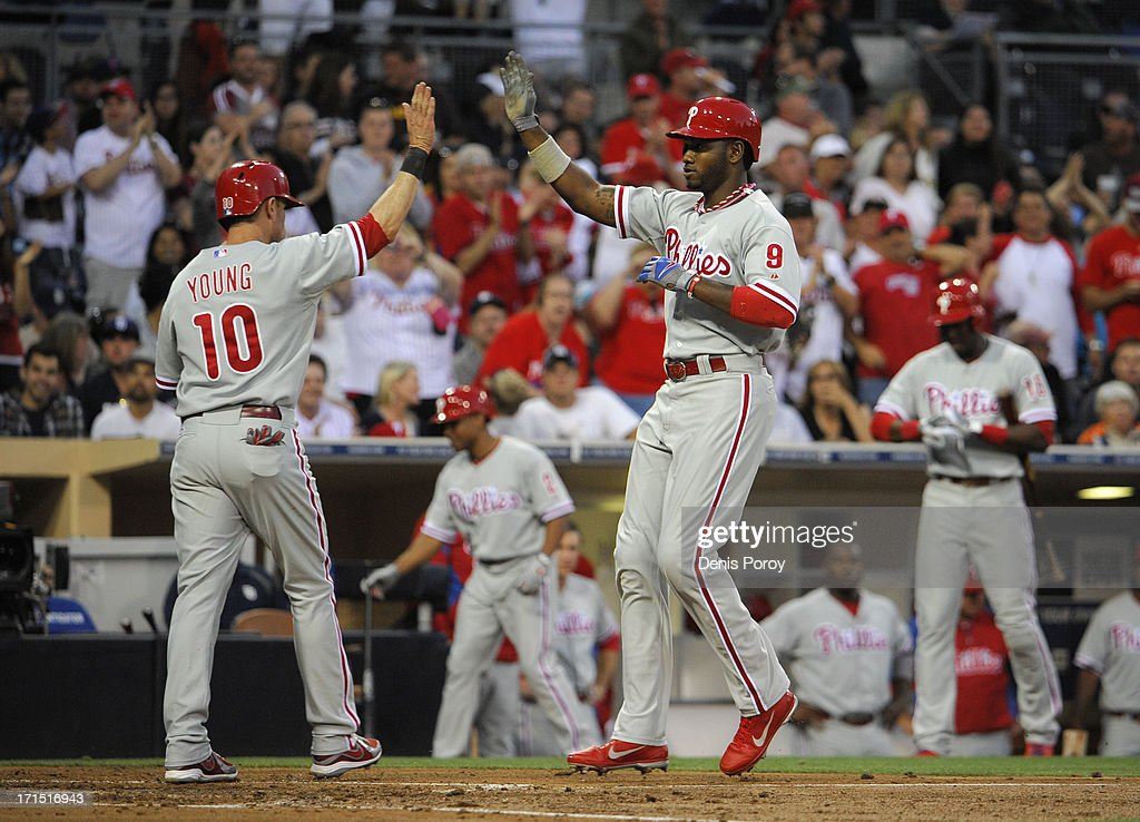 Domonic Brown #9 of the Philadelphia Phillies, left, is congratulated by <a gi-track='captionPersonalityLinkClicked' href=/galleries/search?phrase=Michael+Young+-+Baseball+Player&family=editorial&specificpeople=203149 ng-click='$event.stopPropagation()'>Michael Young</a> #10 after hitting a three-run homer during the third inning of a baseball game against the San Diego Padres at Petco Park on June 25, 2013 in San Diego, California.
