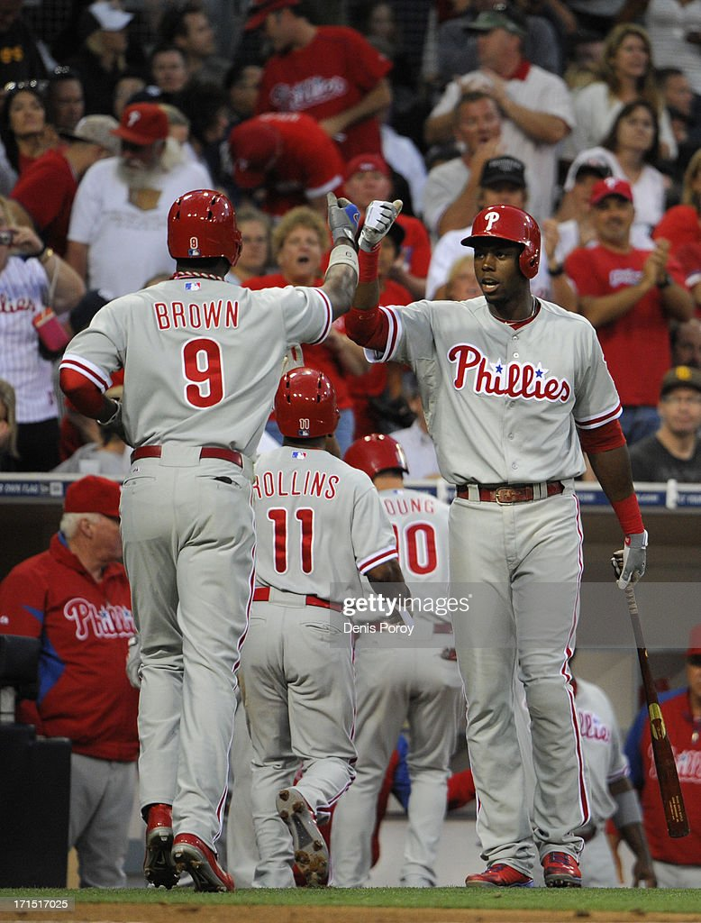 Domonic Brown #9 of the Philadelphia Phillies, left, is congratulated by <a gi-track='captionPersonalityLinkClicked' href=/galleries/search?phrase=John+Mayberry+Jr.&family=editorial&specificpeople=4959058 ng-click='$event.stopPropagation()'>John Mayberry Jr.</a> #15 after hitting a three-run homer during the third inning of a baseball game against the San Diego Padres at Petco Park on June 25, 2013 in San Diego, California.
