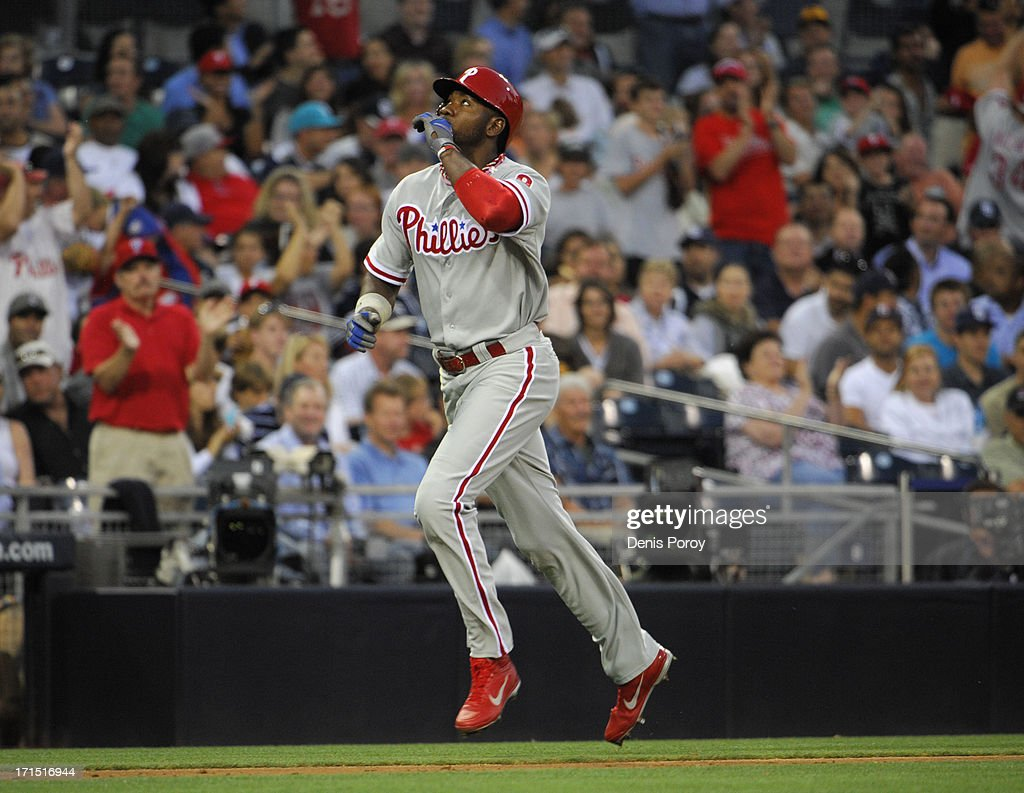 Domonic Brown #9 of the Philadelphia Phillies looks skyward after hitting a three-run homer during the third inning of a baseball game against the San Diego Padres at Petco Park on June 25, 2013 in San Diego, California.