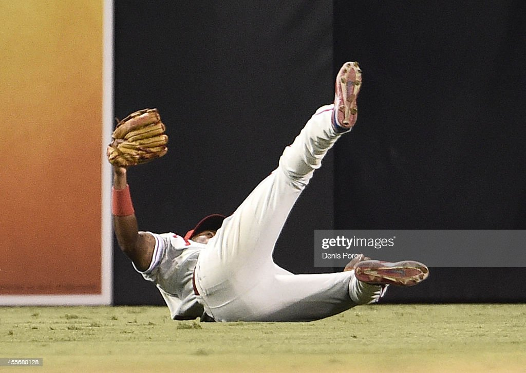 <a gi-track='captionPersonalityLinkClicked' href=/galleries/search?phrase=Domonic+Brown&family=editorial&specificpeople=6900643 ng-click='$event.stopPropagation()'>Domonic Brown</a> #9 of the Philadelphia Phillies makes a diving catch on a ball hit by Jedd Gyorko #9 of the San Diego Padres during the third inning of a baseball game at Petco Park September, 18, 2014 in San Diego, California.