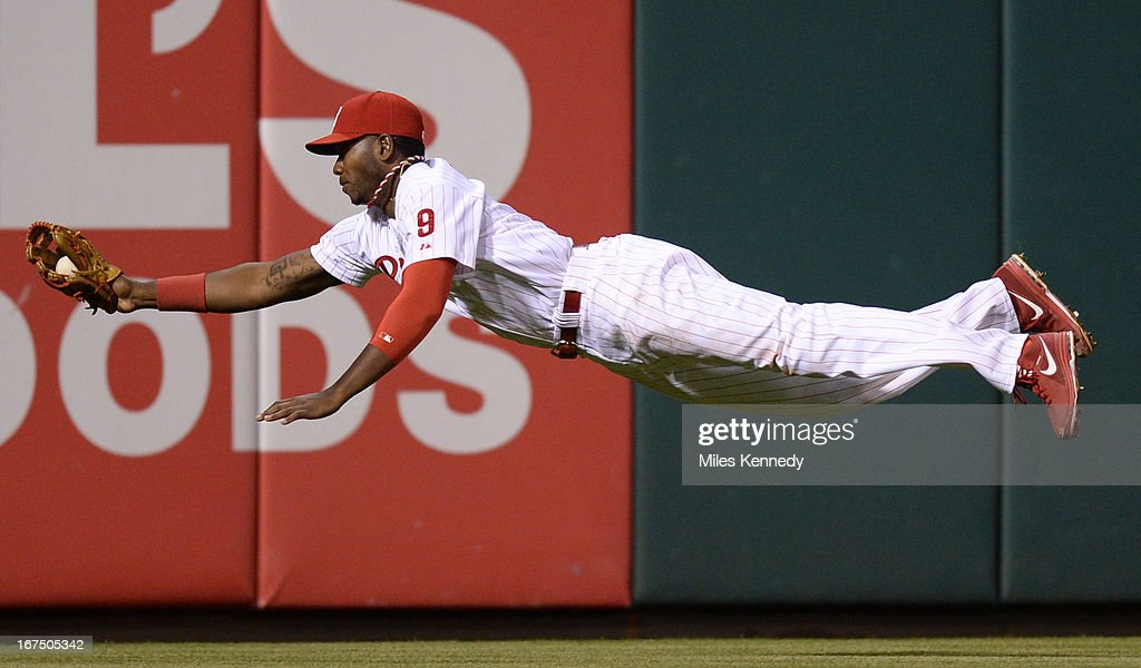 Domonic Brown #9 of the Philadelphia Phillies makes a diving catch against the Pittsburgh Pirates in the fifth inning on April 24, 2013 at Citizens Bank Park in Philadelphia, Pennsylvania. The Pirates won 5-3.