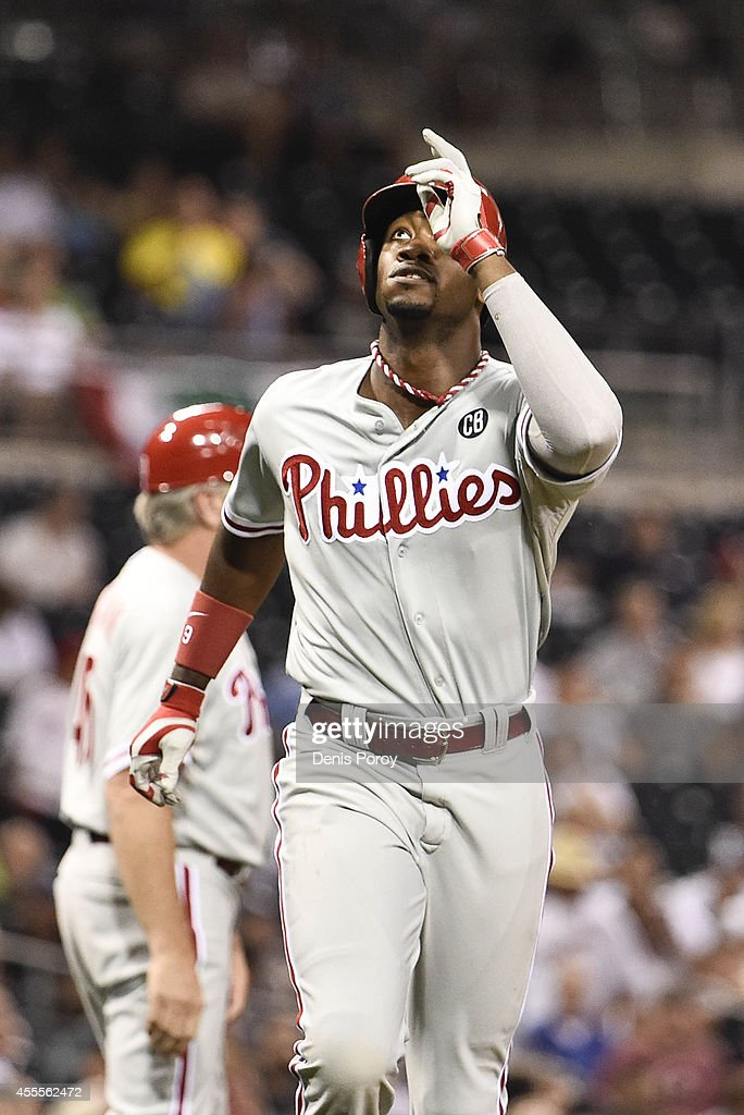 <a gi-track='captionPersonalityLinkClicked' href=/galleries/search?phrase=Domonic+Brown&family=editorial&specificpeople=6900643 ng-click='$event.stopPropagation()'>Domonic Brown</a> #9 of the Philadelphia Phillies points skyward after hitting a solo home run during the second inning of a baseball game against the San Diego Padres at Petco Park September, 16, 2014 in San Diego, California.