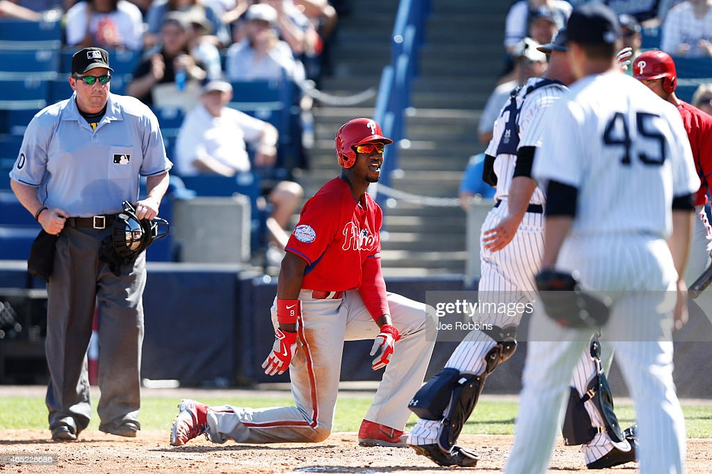 <a gi-track='captionPersonalityLinkClicked' href=/galleries/search?phrase=Domonic+Brown&family=editorial&specificpeople=6900643 ng-click='$event.stopPropagation()'>Domonic Brown</a> #9 of the Philadelphia Phillies reacts after being tagged out on a play at the plate in the fifth inning of the game against the New York Yankees at George M. Steinbrenner Field on March 4, 2015 in Tampa, Florida. The Phillies defeated the Yankees 3-1.