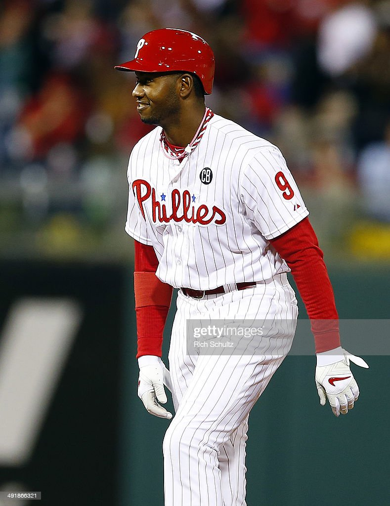 <a gi-track='captionPersonalityLinkClicked' href=/galleries/search?phrase=Domonic+Brown&family=editorial&specificpeople=6900643 ng-click='$event.stopPropagation()'>Domonic Brown</a> #9 of the Philadelphia Phillies reacts after hitting a three run double in the seventh inning against the Cincinnati Reds in a game at Citizens Bank Park on May 17, 2014 in Philadelphia, Pennsylvania. The Phillies defeated the Reds 12-1.