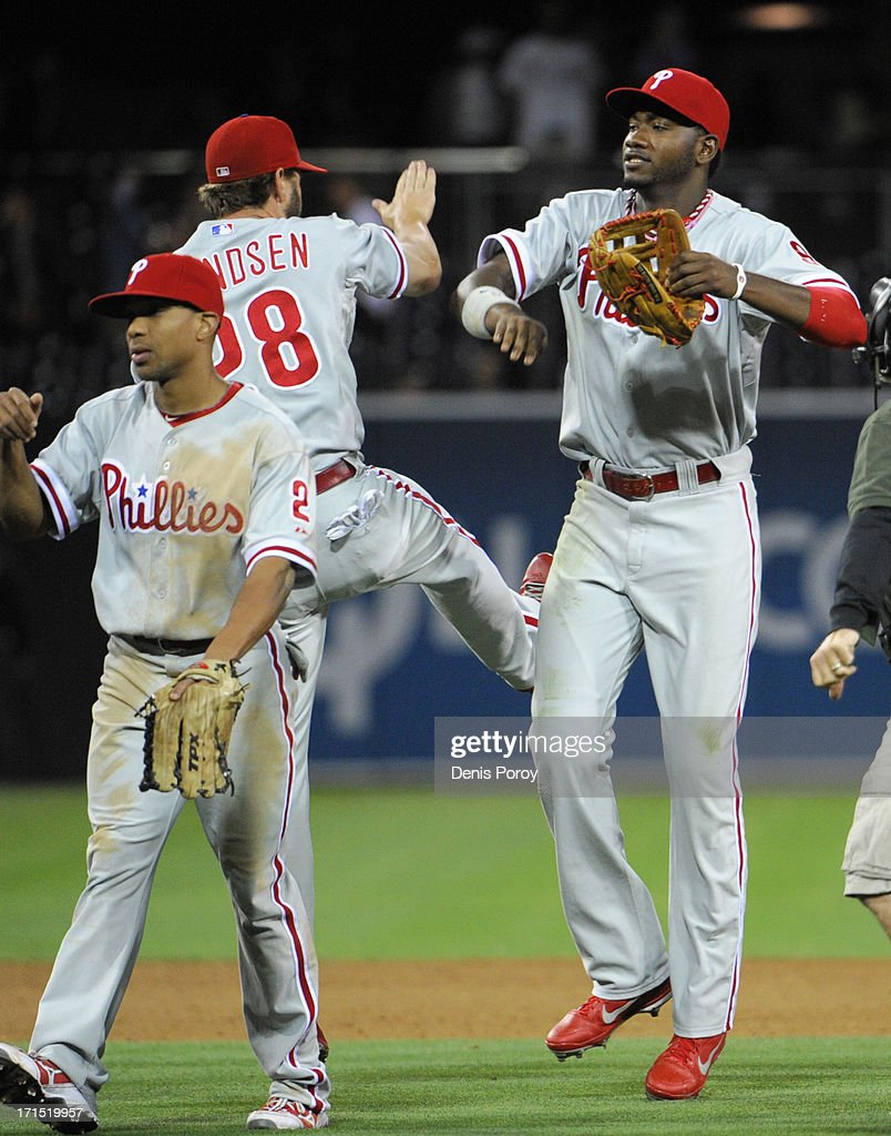 Domonic Brown #9 of the Philadelphia Phillies, right, and <a gi-track='captionPersonalityLinkClicked' href=/galleries/search?phrase=Kevin+Frandsen&family=editorial&specificpeople=3982842 ng-click='$event.stopPropagation()'>Kevin Frandsen</a> #28 celebrate after the Phillies beat the San Diego Padres 6-2 in a baseball game at Petco Park on June 25, 2013 in San Diego, California.