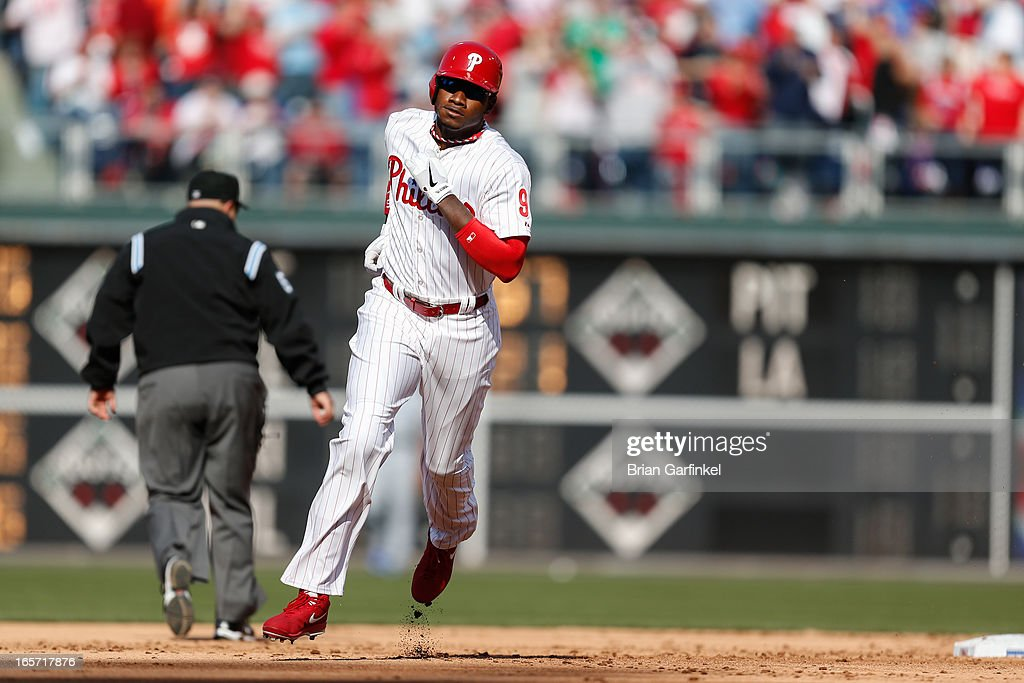 Domonic Brown #9 of the Philadelphia Phillies runs the bases atet hitting a home run in the second inning of the Opening Day game against the Kansas City Royals at Citizens Bank Park on April 5, 2013 in Philadelphia, Pennsylvania.
