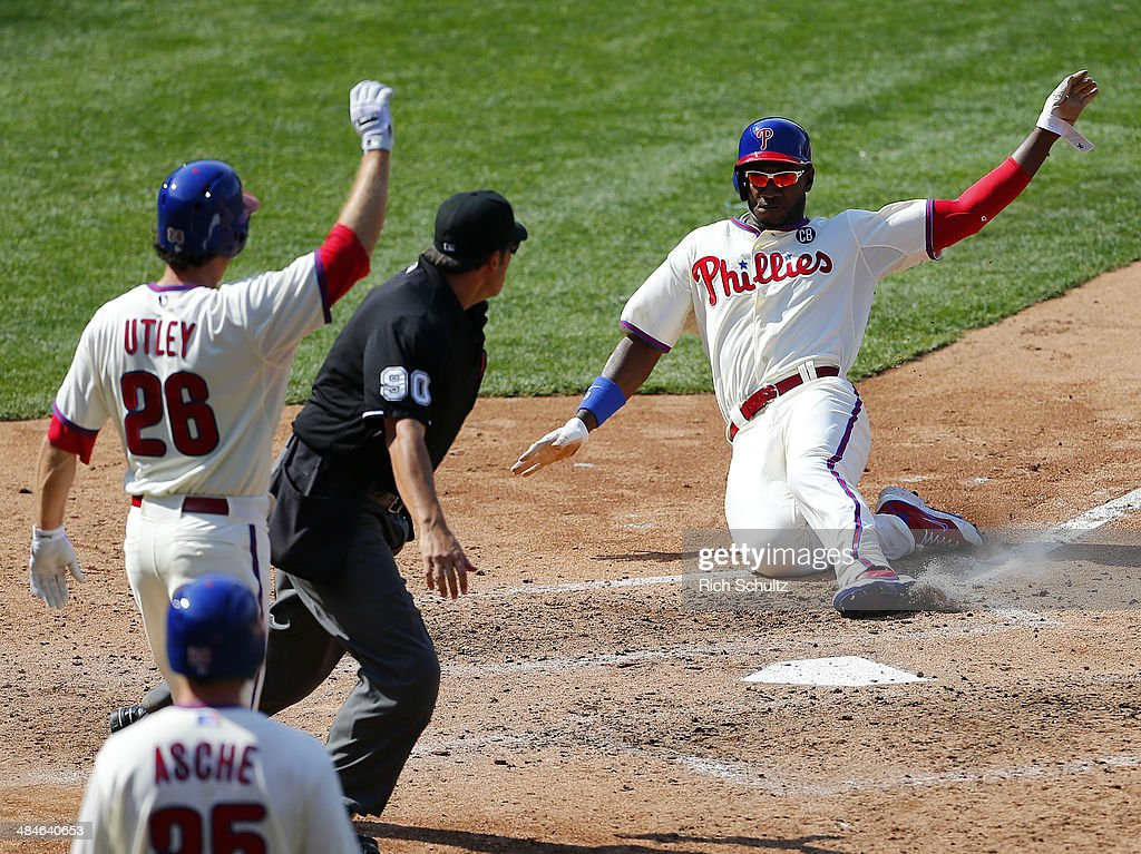 <a gi-track='captionPersonalityLinkClicked' href=/galleries/search?phrase=Domonic+Brown&family=editorial&specificpeople=6900643 ng-click='$event.stopPropagation()'>Domonic Brown</a> #9 of the Philadelphia Phillies scores after <a gi-track='captionPersonalityLinkClicked' href=/galleries/search?phrase=Chase+Utley&family=editorial&specificpeople=161391 ng-click='$event.stopPropagation()'>Chase Utley</a> #26 on a two-run double by Wil Nieves #21 during the fifth inning in a game against the Miami Marlins at Citizens Bank Park on April 13, 2014 in Philadelphia, Pennsylvania. The Phillies defeated the Marlins 4-3.