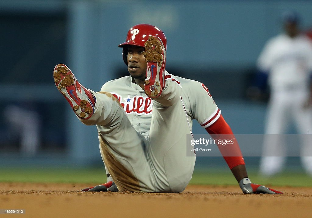 <a gi-track='captionPersonalityLinkClicked' href=/galleries/search?phrase=Domonic+Brown&family=editorial&specificpeople=6900643 ng-click='$event.stopPropagation()'>Domonic Brown</a> #9 of the Philadelphia Phillies trips after stealing second base in the second inning against the Los Angeles Dodgers at Dodger Stadium on April 24, 2014 in Los Angeles, California.