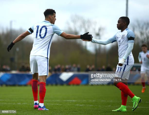 Domonik Solanke of England celebrates with Ademola Lookman of England after he scores his sides first goal from the penalty spot during the UEFA U20...