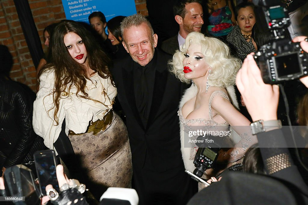 Domonique Echeverria, Jean Paul Gaultier and <a gi-track='captionPersonalityLinkClicked' href=/galleries/search?phrase=Amanda+Lepore&family=editorial&specificpeople=213255 ng-click='$event.stopPropagation()'>Amanda Lepore</a> attend the VIP reception and viewing for The Fashion World of Jean Paul Gaultier: From the Sidewalk to the Catwalk at the Brooklyn Museum on October 23, 2013 in the Brooklyn borough of New York City.