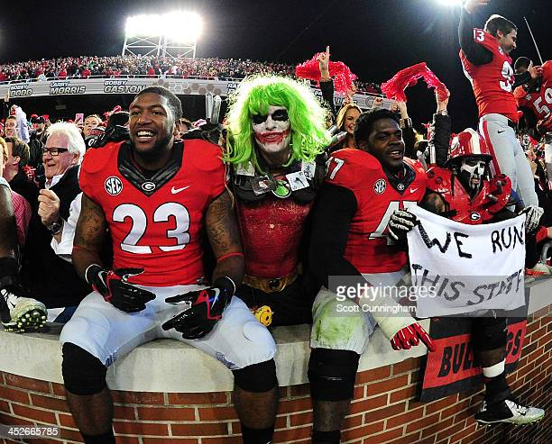 Domonique Noble and Ray Drew of the Georgia Bulldogs celebrate after the game against the Georgia Tech Yellow Jackets at Bobby Dodd Stadium on...