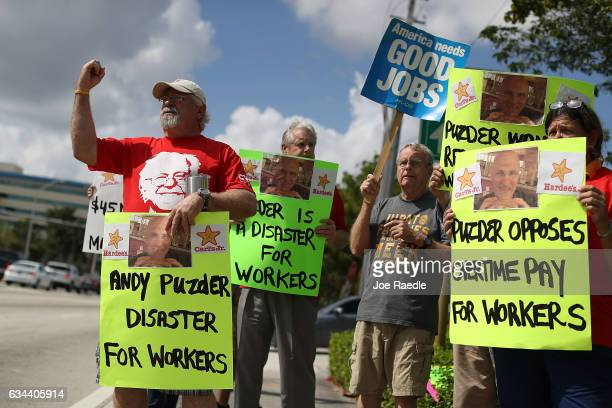 Don Abicht joins with other South Florida union members and activists as they protest in front of Senator Marco Rubio's District Office asking him to...