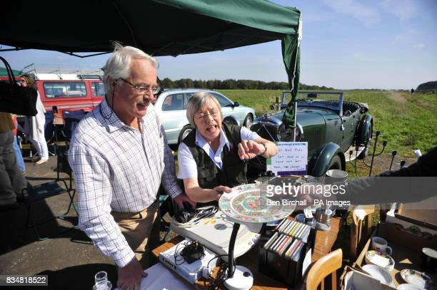 Don and Yvette Courtney from Chedworth on a stall at a car boot sale at Manor Farm Chedworth Gloucestershire
