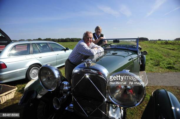 Don and Yvette Courtney from Chedworth with their vintage 1932 Lanonda car at a car boot sale at Manor Farm Chedworth Gloucestershire