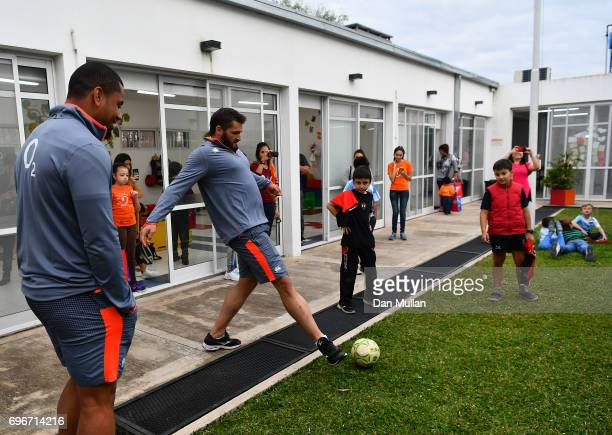 Don Armand of England plays football with patients during a visit to Fundacion Mateo Esquivo a local children's cancer hospital on June 16 2017 in...