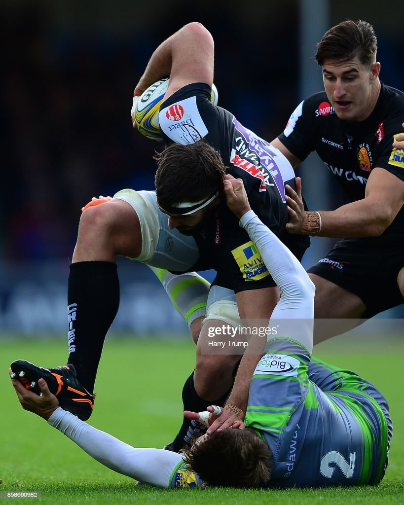 Don Armand of Exeter Chiefs(C) is tackled by Toby Flood of Newcastle Falcons(floor) during the Aviva Premiership match between Exeter Chiefs and Newcastle Falcons at Sandy Park on October 7, 2017 in Exeter, England.