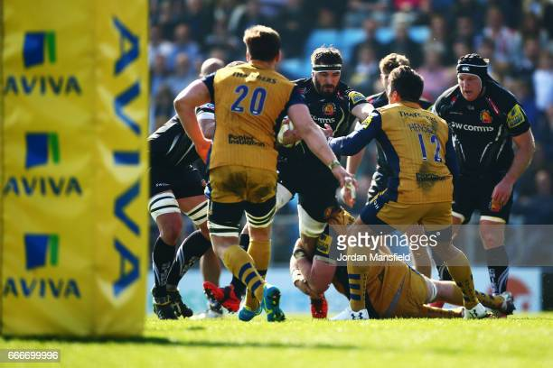 Don Armand of Exeter is tackled by James Phillips of Bristol during the Aviva Premiership match between Exeter Chiefs and Bristol Rugby at Sandy Park...