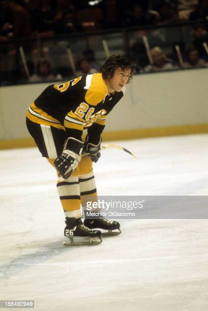 Don Awrey of the Boston Bruins rests during an NHL game against the New York Rangers circa 1972 at the Madison Square Garden in New York New York