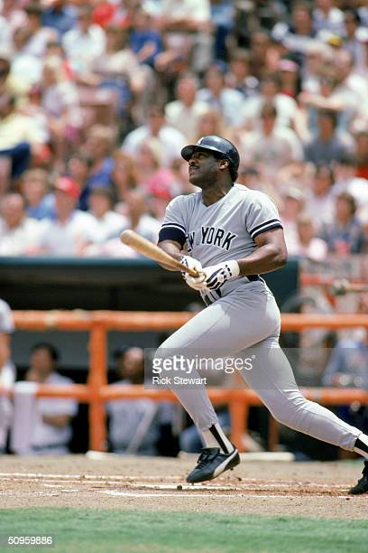 Don Baylor of the New York Yankees makes contact with a pitch during a game against the Anaheim Angels on May 25 1985 at Angel Stadium in Anaheim...