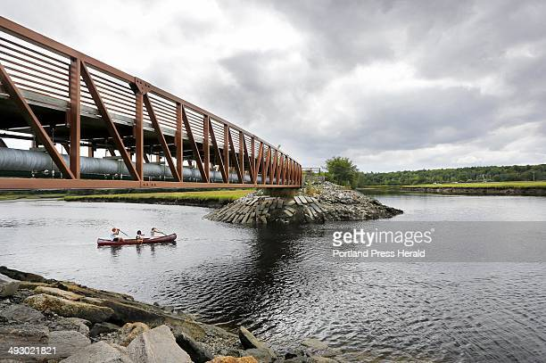 Don Brown of San Francisco CA paddles a canoe through the Scarborough Marsh with his wife Nancy Frumkes and daughter Anji Frumkes while on vacation...