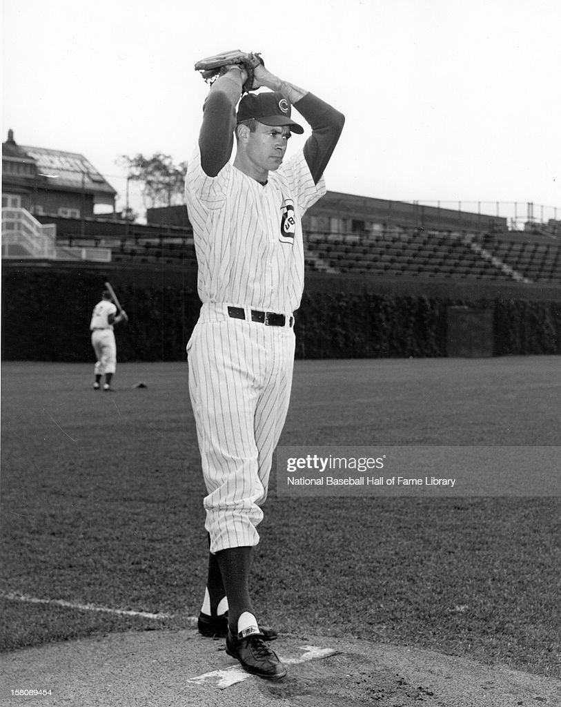 Don Cardwell #43 of the Chicago Cubs warms up before an MLB game circa 1961 at Wrigley Field in Chicago, Illinois.