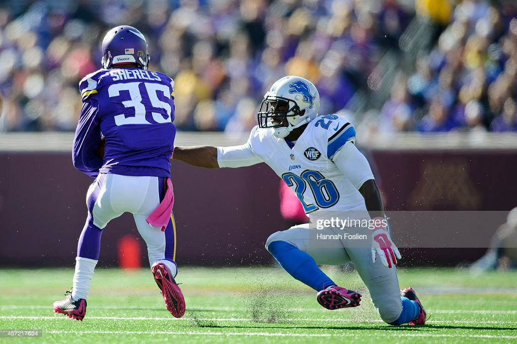 Don Carey of the Detroit Lions misses a tackle of Marcus Sherels of the Minnesota Vikings during the game on October 12 2014 at TCF Bank Stadium in...