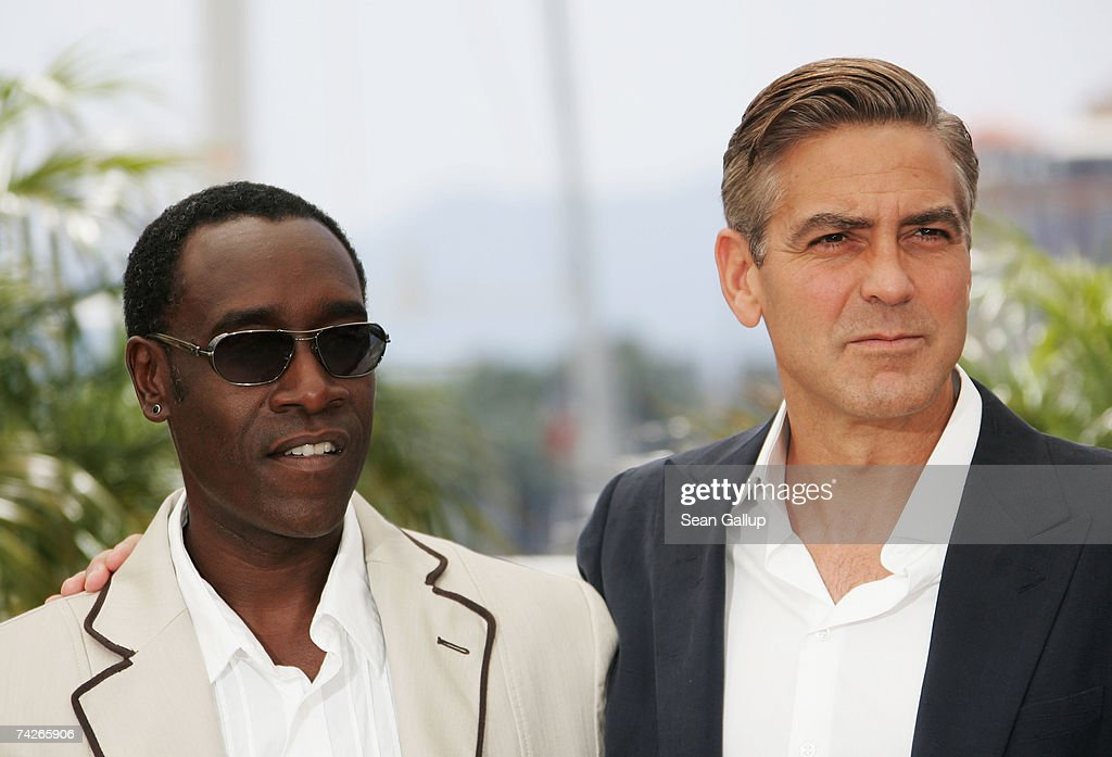 Don Cheadle and George Clooney attend a photocall to promote the film 'Ocean's Thirteen' at the Palais des Festivals during the 60th International Cannes Film Festival on May 24, 2007 in Cannes, France.