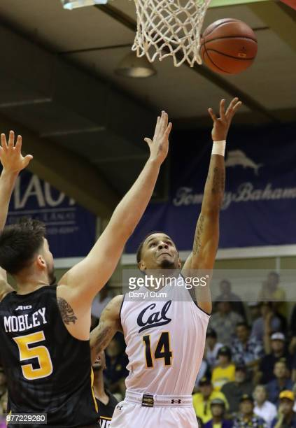Don Coleman of the California Golden Bears lays the ball in ahead of Sean Mobley of the VCU Rams during the second half of their game during the Maui...