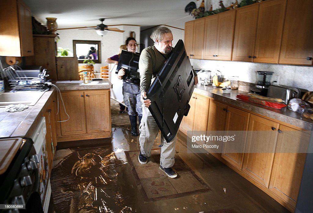 Don DeGraff and his niece Julie DeGraff, both of La Salle, Colorado, carry valuable items out of their home on September 14, 2013 in La Salle, Colorado. Heavy rains for the better part of the week fueled widespread flooding in numerous Colorado towns. The historic flooding forced thousands to evacuate the area and more rain is predicted through the weekend. Don said he already plans to rebuild adding, 'we built it from nothing and we'll do it again.'