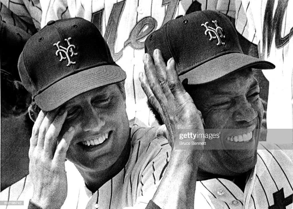 Don Hahn #25 and Willie Mays #24 of the New York Mets laugh over their teammates antics while the Mets take their team photo on March 4, 1973 in St. Petersburg, Florida.