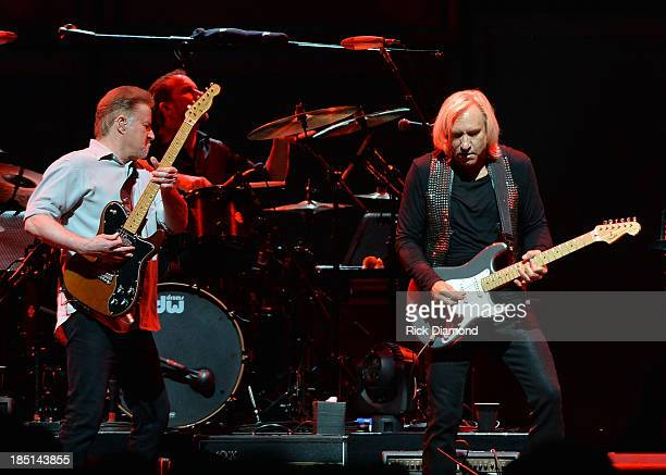 Don Henley and Joe Walsh of the Eagles perform during 'History Of The Eagles Live In Concert' at the Bridgestone Arena on October 16 2013 in...