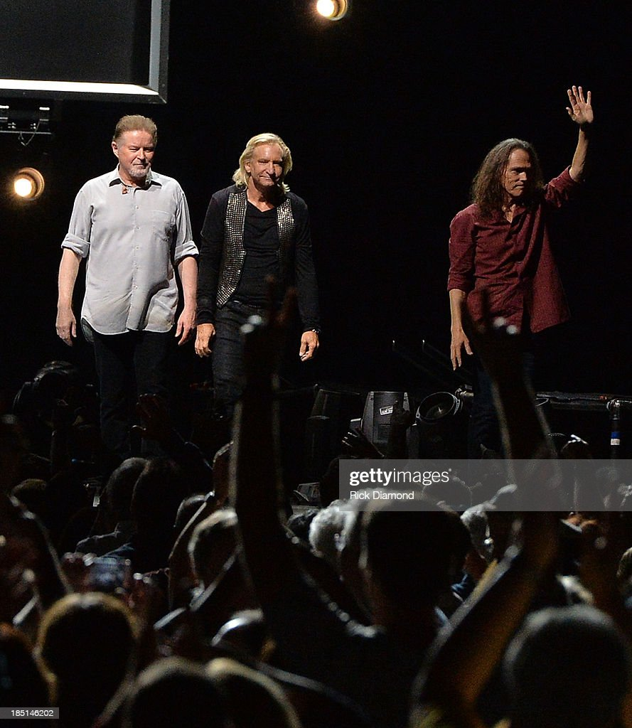 Don Henley, Joe Walsh and Timothy B. Schmit of the Eagles perform during 'History Of The Eagles Live In Concert' at the Bridgestone Arena on October 16, 2013 in Nashville, Tennessee.